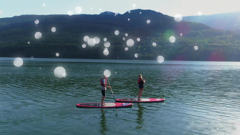 Couple doing paddle board surrounded by white bubbles effect Animation