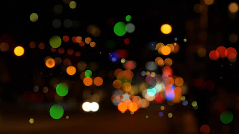 Cityscape surrounded by colorful bokeh effect Animation