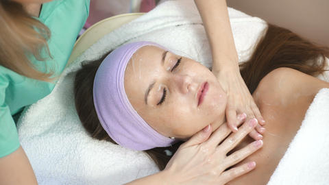 Woman relaxing in spa salon Live Action