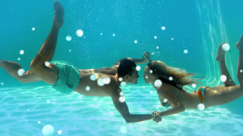 Young couple kissing each other underwater with light effects Animation