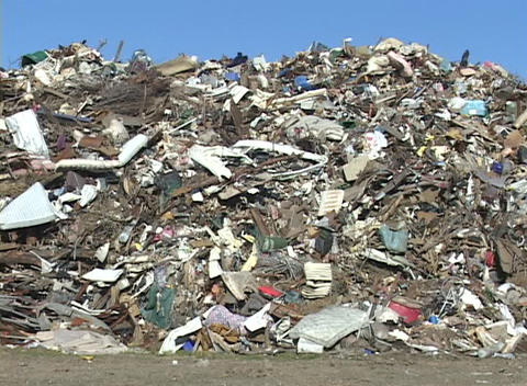Trash and debris from Hurricane Katrina makes a huge mountain at garbage dump Footage