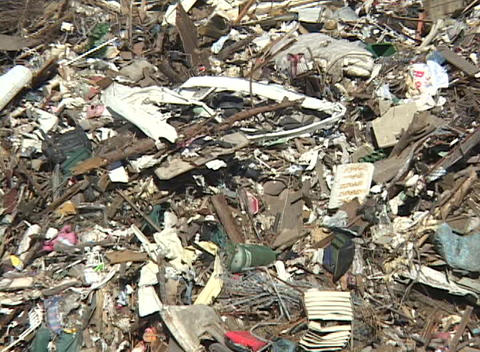 The debris left in the aftermath of Hurricane Katrina creates a huge mountain of trash Footage