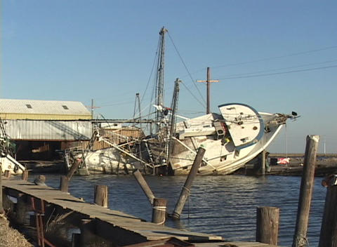 A damaged fishing boat rests on its side after Hurricane Katrina Footage