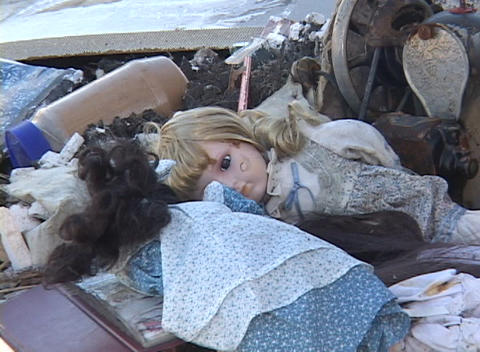 A child's doll lies in the rubble of a house after Hurricane Katrina Footage