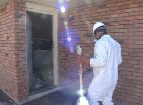 A rescue worker enters a damaged door on a home... Stock Video Footage
