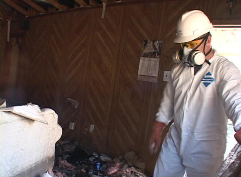 A worker clears debris from a home damaged by Hurricane... Stock Video Footage