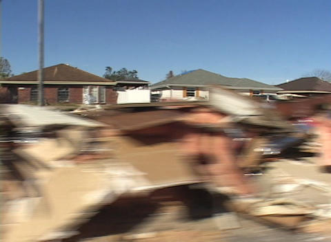 Debris piled up along the streets of a residential area... Stock Video Footage