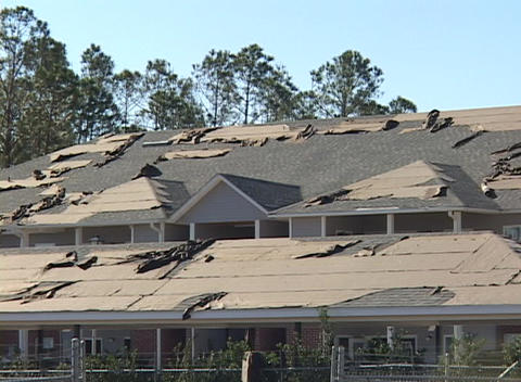 The roof of a commercial building shows the damage done... Stock Video Footage