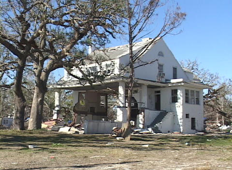 A house shows the damage done by Hurricane Katrina Stock Video Footage