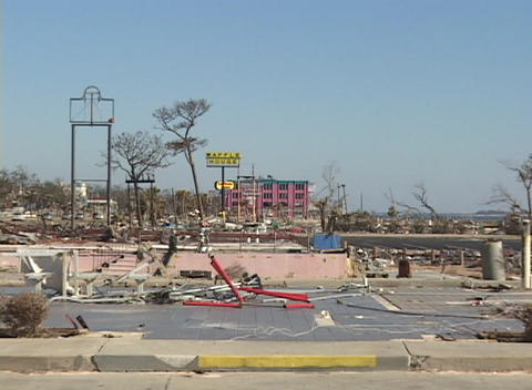 A wrecked commercial area shows the destruction of... Stock Video Footage