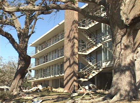 A damaged apartment building shows the destruction caused... Stock Video Footage