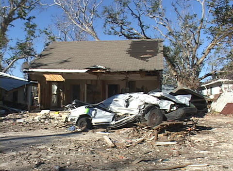 A crushed car in front of a home shows the destruction... Stock Video Footage