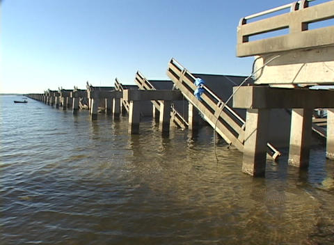 A collapsed bridge shows the destruction caused by... Stock Video Footage
