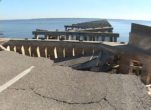 A collapsed highway and bridge show the destructive... Stock Video Footage