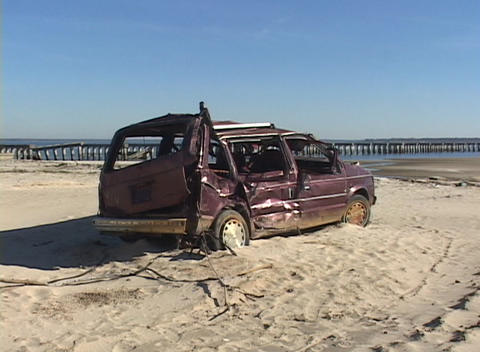 A destroyed minivan abandoned on a beach shows the destructive power of Hurricane Katrina Footage