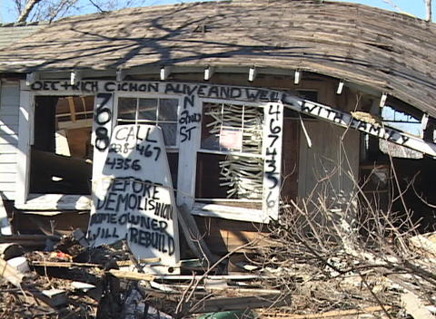 A message on a destroyed house notifies relatives that... Stock Video Footage