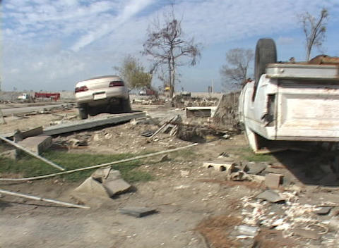 Cars and debris strewn all over show the destruction... Stock Video Footage