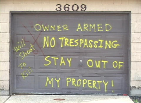 A home owner puts a message on their garage door warning trespassers to stay away after Hurricane Ka Footage