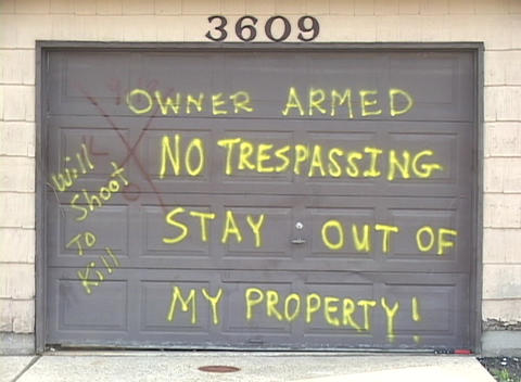 A home owner puts a message on their garage door warning... Stock Video Footage