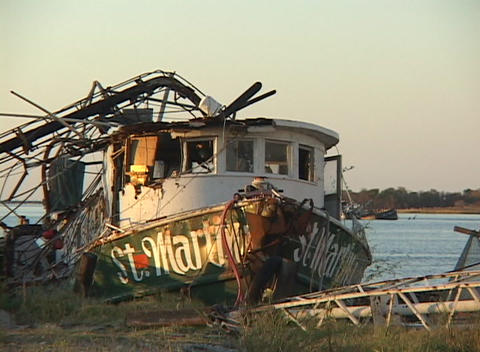 A ruined fishing boat shows the destruction caused by... Stock Video Footage