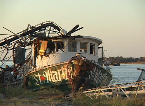 A ruined fishing boat shows the destruction caused by Hurricane Katrina Live Action