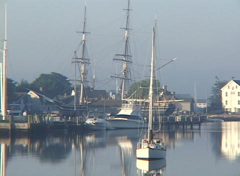 Several docked boats rest in a harbor Stock Video Footage