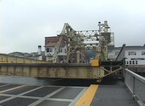 A drawbridge slowly rises in the air Stock Video Footage