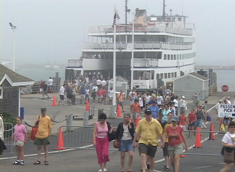 Passengers walk off of a ferry Stock Video Footage