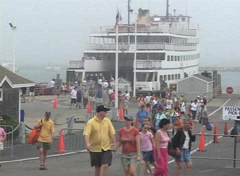 Passengers walk off of a ferry Footage