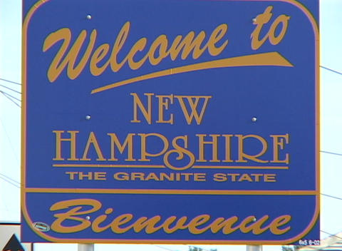 A blue sign welcomes visitors to the state of New Hampshire Stock Video Footage