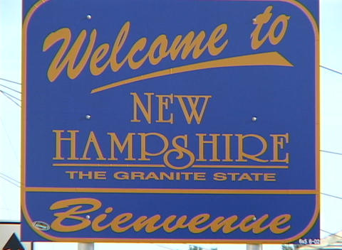 A blue sign welcomes visitors to the state of New Hampshire Live Action