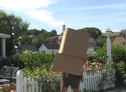 A deliveryman drops off packages in a residential... Stock Video Footage