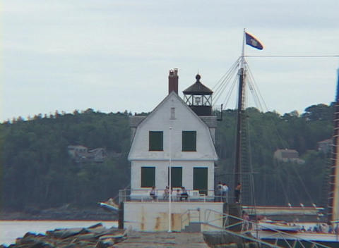A sailing ship passes a jetty Stock Video Footage