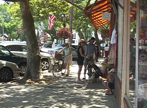 A medium shot of a sidewalk in hometown America Footage