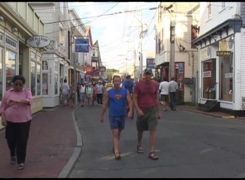 Medium-shot of tourists walking through an all-American... Stock Video Footage