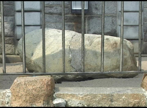 A close-up shot of the famous Plymouth Rock in Massachusetts Stock Video Footage