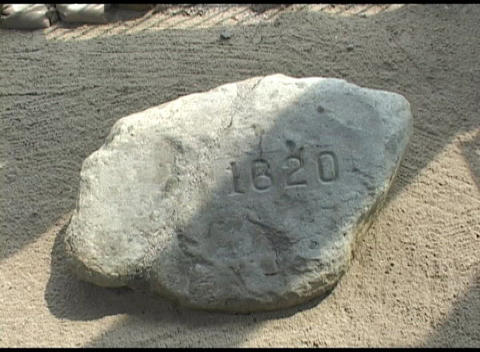 Close-up shot of Plymouth Rock inscribed with the year, 1620 Footage