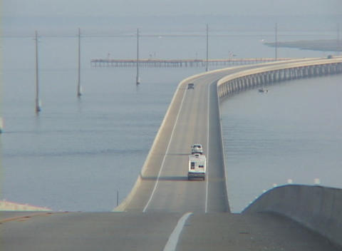 A motor home drives down a causeway in Florida Stock Video Footage