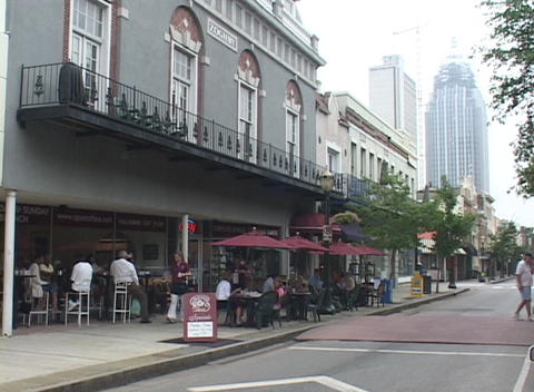 Guests enjoy a restaurant meal in post Katrina New Orleans Stock Video Footage