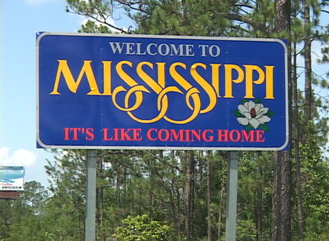 "A highway sign says Welcome to Mississippi."""" Footage"