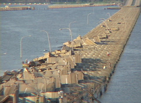 People work on a destroyed causeway along the Gulf Coast... Stock Video Footage