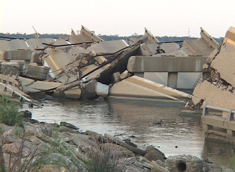 Water flows around a destroyed causeway along the Gulf... Stock Video Footage
