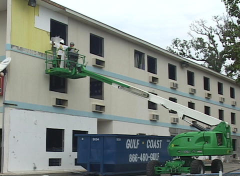 Construction workers use a crane to restore damaged... Stock Video Footage