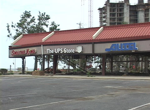 A heavily damaged strip mall stands in the wake of... Stock Video Footage