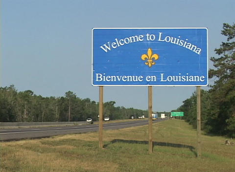 A highway sign greets visitors to Louisiana Stock Video Footage