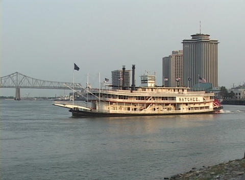 A paddle boat crosses the Mississippi River with New Orleans in the background Footage