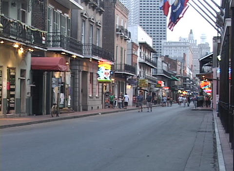 Pedestrians walk in the French Quarter of New Orleans Stock Video Footage