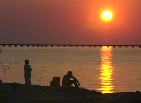 Men fish along the Gulf Coast Stock Video Footage