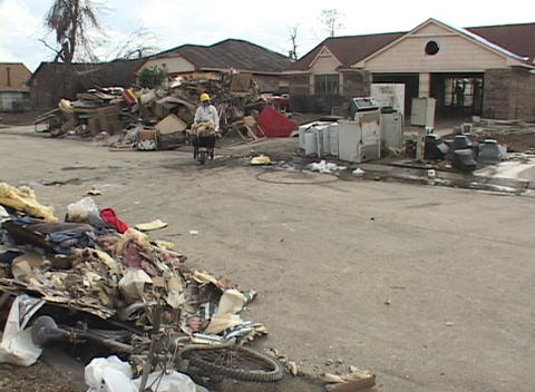 Workers clean out flooded houses following Hurricane Katrina Stock Video Footage