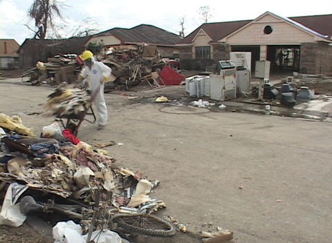 Workers clean out flooded houses following Hurricane Katrina Footage